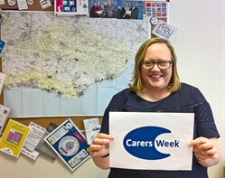 Jennifer Twist holding carers' week placard