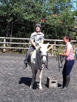 photo of carer horseriding