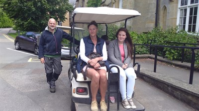 photo of carers on a golfcart