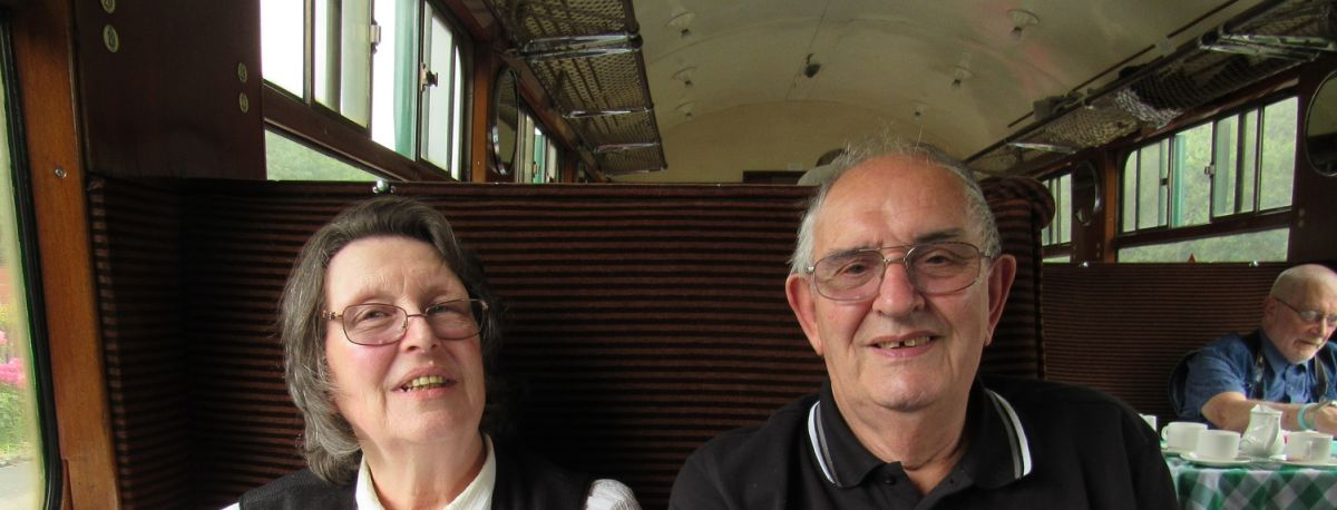 photo of elderly couple on bluebell railway trip