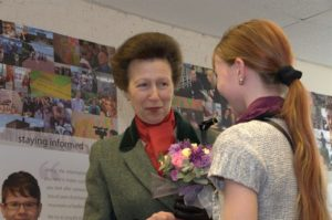 photo of HRH Princess Anne with a young carer (2012)