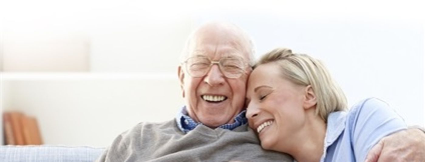 photo of grandfather and carer laughing